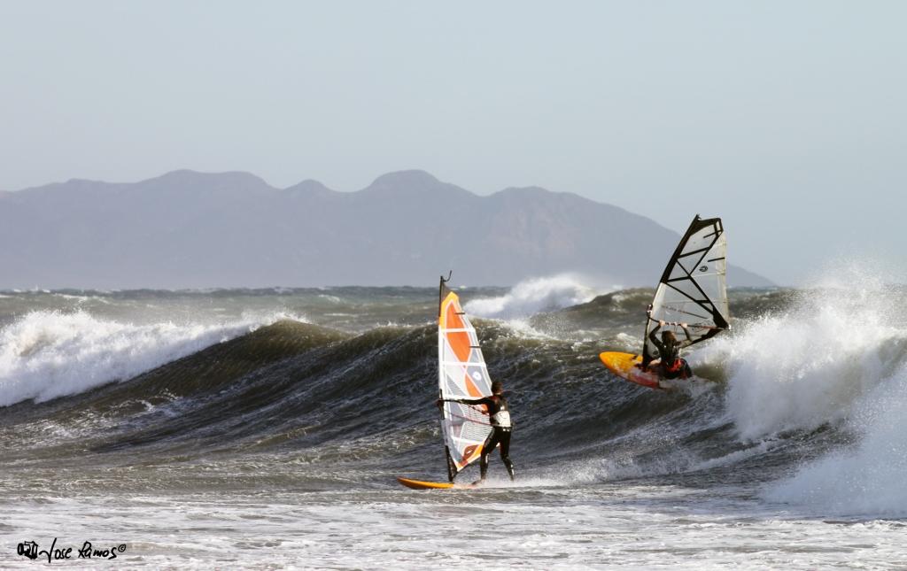 Fran Perez and Jose sharing a wave.